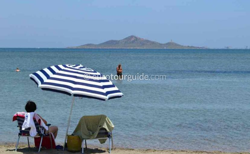 Top 10 things to do in and around Los Nietos Mar Menor Costa Calida Murcia Spain, Sunbathing on the beach one of many things to do and places to visit here.