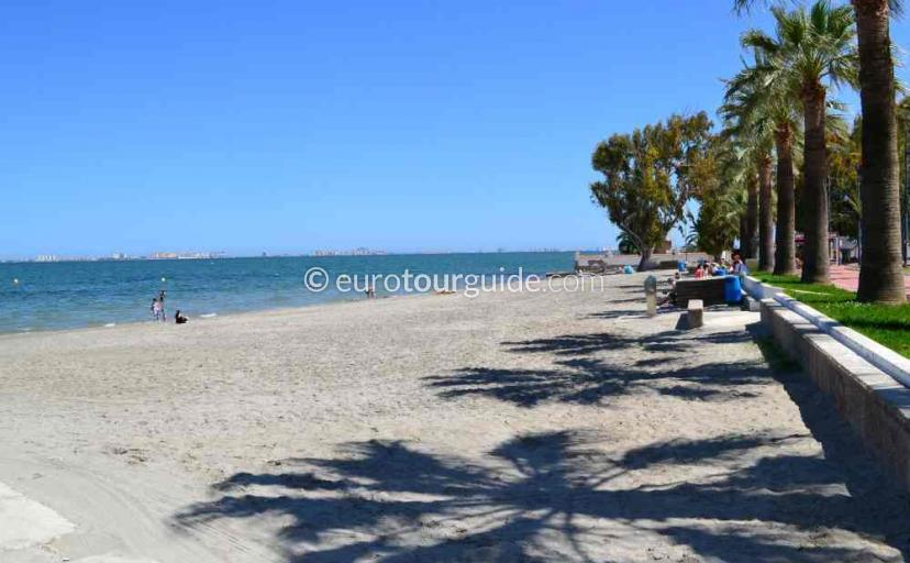 Places to visit in Santiago de la Ribera Mar Menor Murcia Spain, walking along past the palms on the beach isone of many things to do.